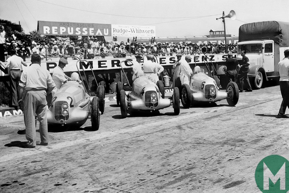 Mercedes line-up in 1935, with cars for Rudolf Caracciola, Manfred von Brauchitsch and Luigi Fagioli in the pits