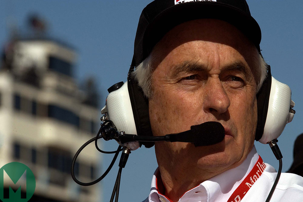 Roger Penske watches his cars in Phoenix 2002