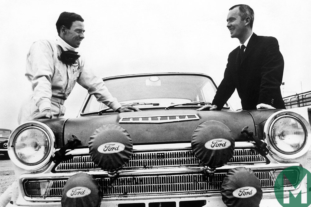 Jim Clark and his co-driver Brian Melia prepare for the 1966 RAC Rally with their works Lotus Cortina