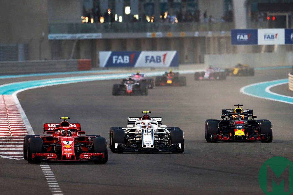 Kimi Räikkönen Ferrari, Charles Leclerc Sauber and Daniel Ricciardo Red Bull battle at the 2018 Abu Dhabi GP