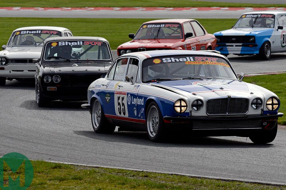 David Howard in his  Jaguar XJ12 seeks to hold off nimbler rivals at Oulton Park