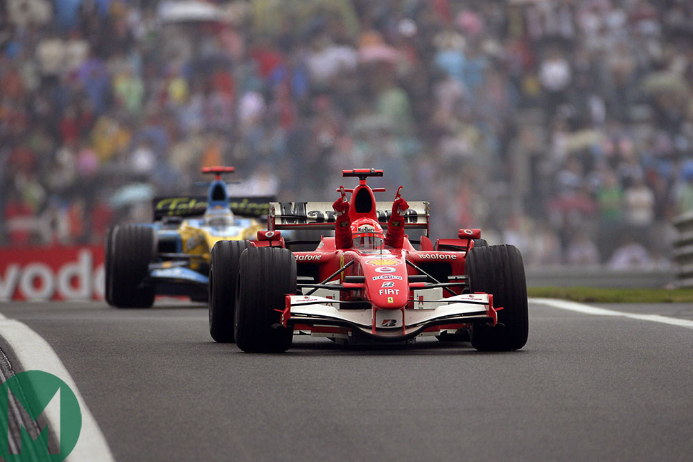 Michael Schumacher in his Ferrari celebrates his 2006 Chinese GP win ahead of Fernando Alonso's Renault