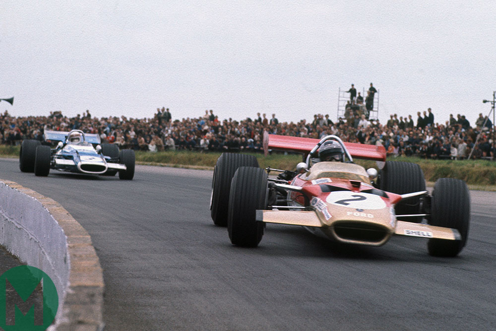 Jochen Rindt in a Lotus leads Jackie Stewart in a Matra in the 1969 British Grand Prix