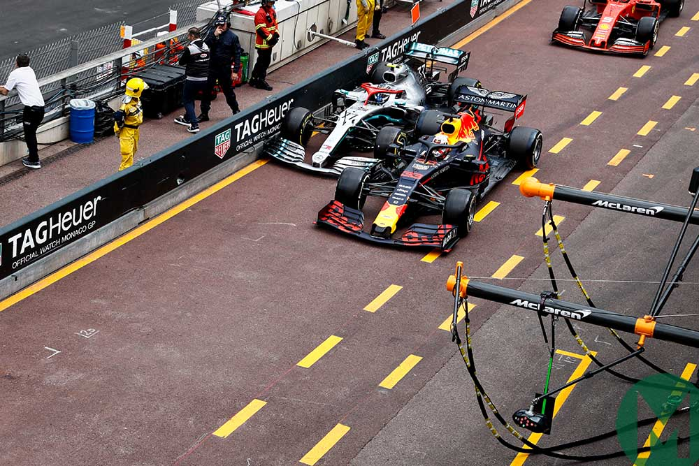 Max Verstappen and Valtteri Bottas side-by-side in the pit-lane