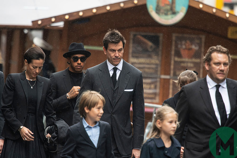 Toto Wolff with Niki Laudas wife Birgit and Lewis Hamilton at funeral