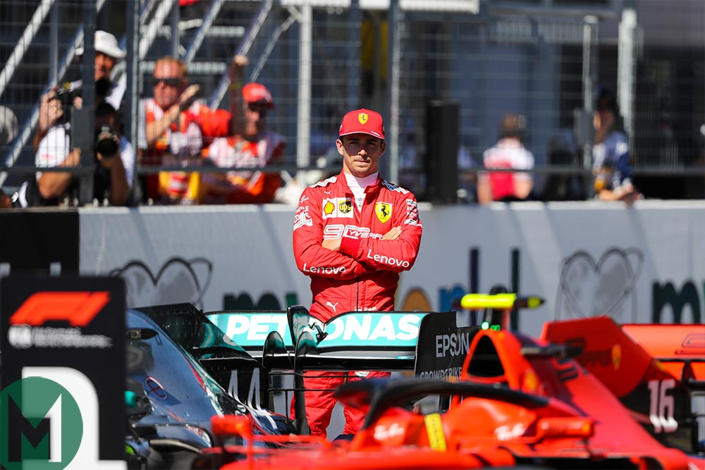 Charles Leclerc looks at his car parked in the No1 position after qualifying on pole for the 2019 Austrian Grand Prix