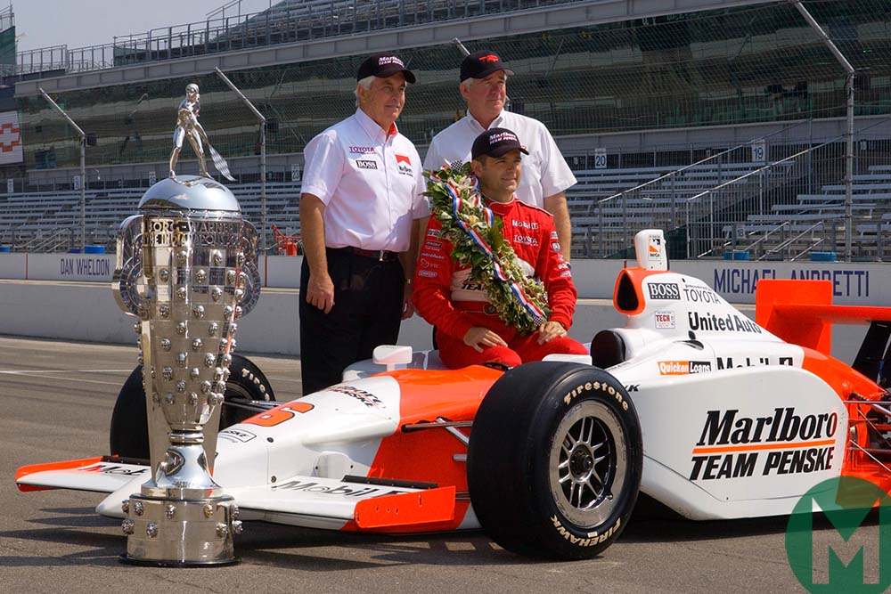 Gil de Ferran with his 2003 Indy 50-winning Penske and the race trophy