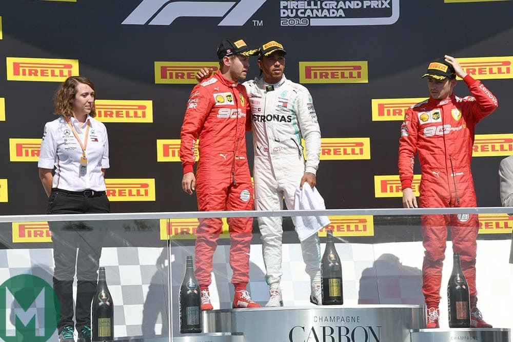 Lewis Hamilton invites Sebastian Vettel onto the top step of the podium after the 2019 Canadian Grand Prix