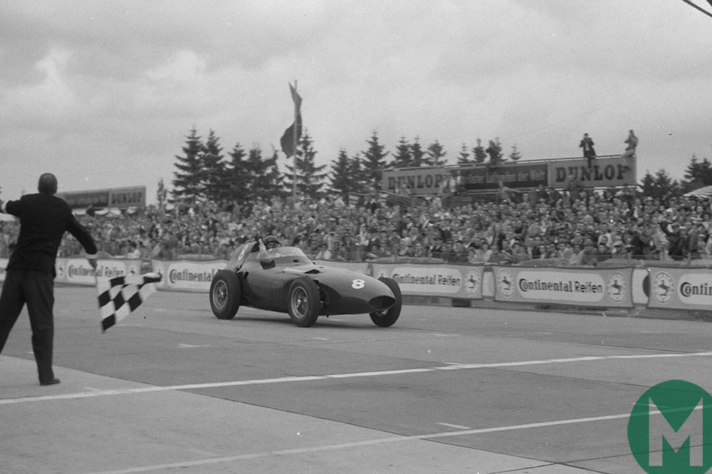 Tony Brooks in a Vanwall takes the flag after a magnificent 1958 German Grand Prix comeback win