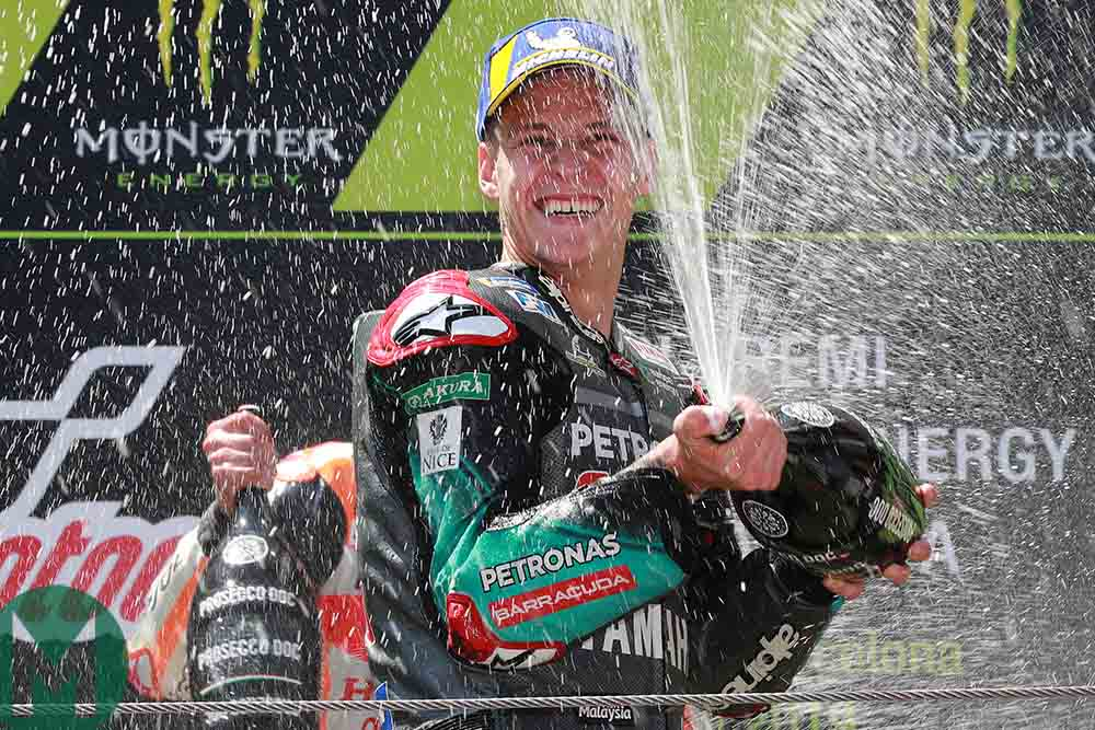 Fabio Quartararo celebrates on the podium