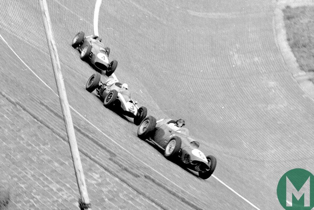 Dan Gurney's Ferrari leads Masten Gregory's Cooper and Tony Brooks' Ferrari on AVUS's notorious banking