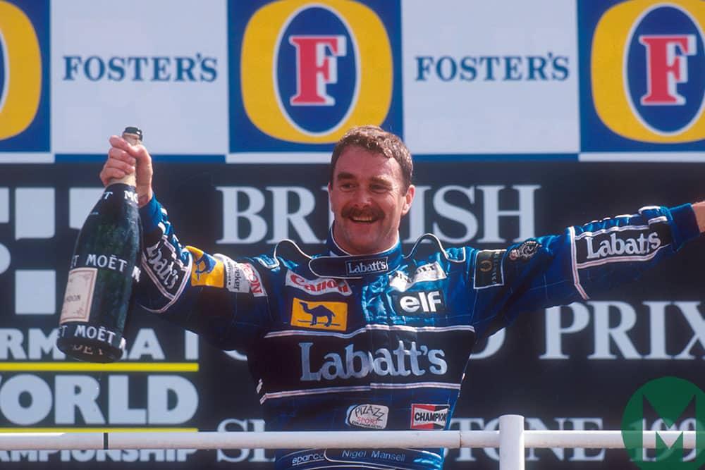 Nigel Mansell on the podium after winning the 1992 British Grand Prix