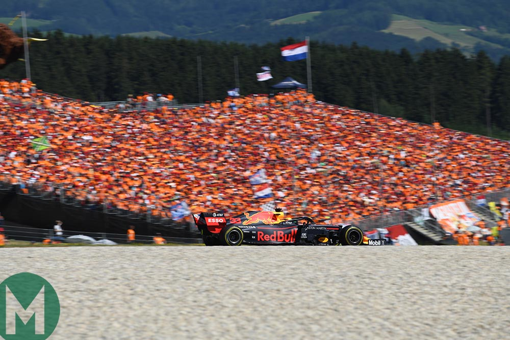 Max Verstappen in front of a grandstand of his orange army supporters at the 2019 Austrian Grand Prix