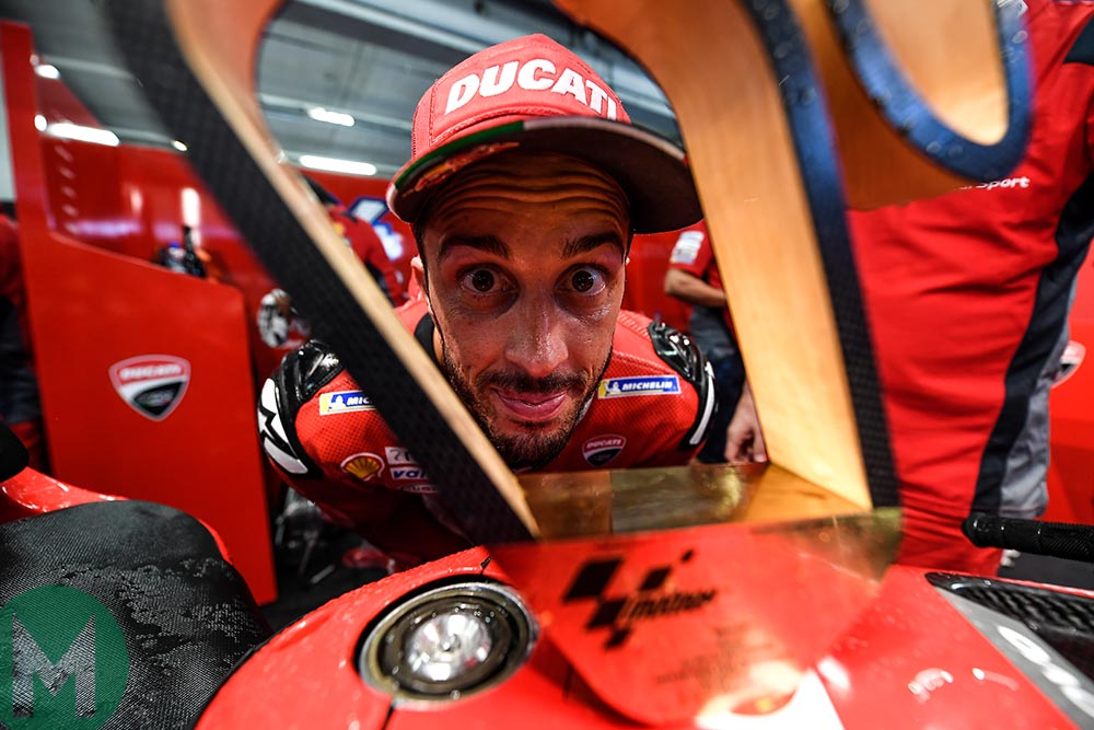 Andreas Dovizioso stares through his winner's trophy from the 2019 MotoGP Austrian Grand Prix