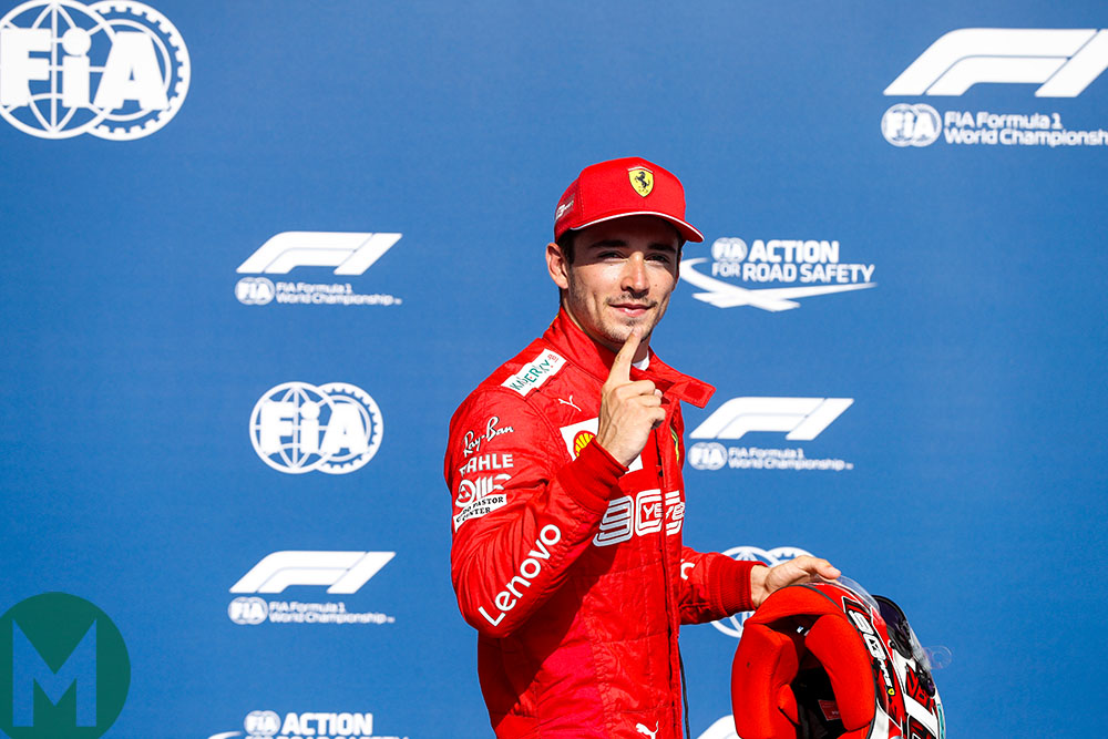 Charles Leclerc raises his finger to indicate his number one slot on the grid for the 2019 Belgian Grand Prix