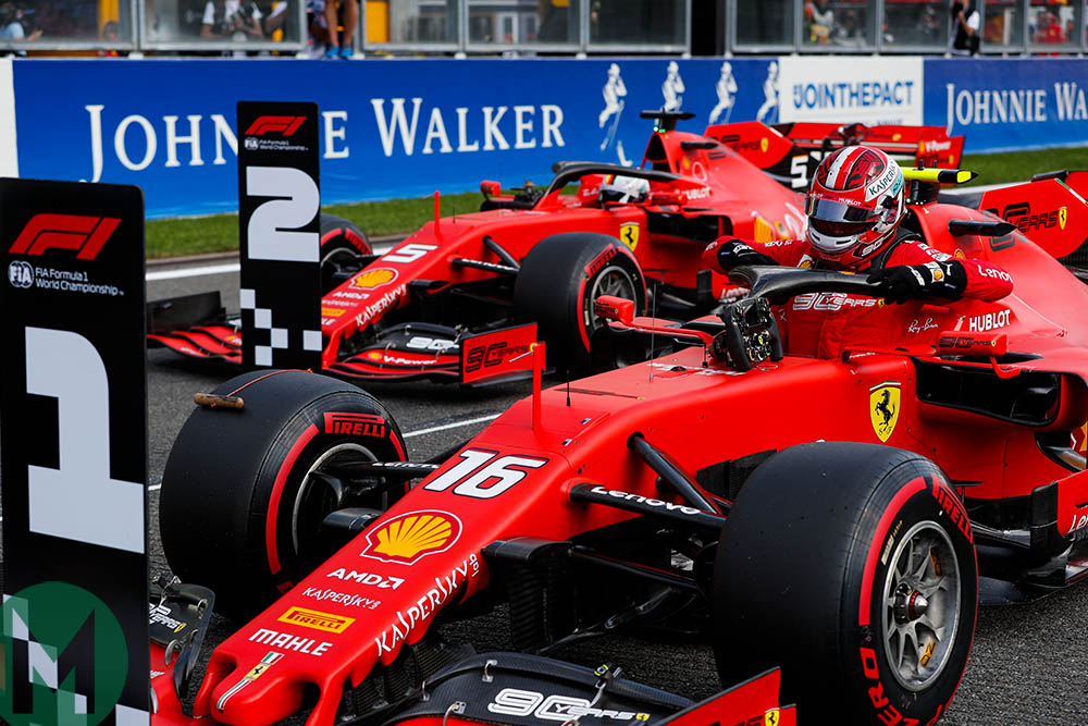 Charles Leclerc and Sebastian Vettel park their Ferraris behind the one and two signs after qualifying for the 2019 Belgian Grand Prix