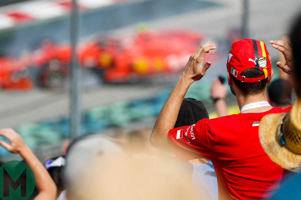 Ferrari fans watch as Charles Leclerc spins into the barrier at the 2019 Hungarian Grand Prix