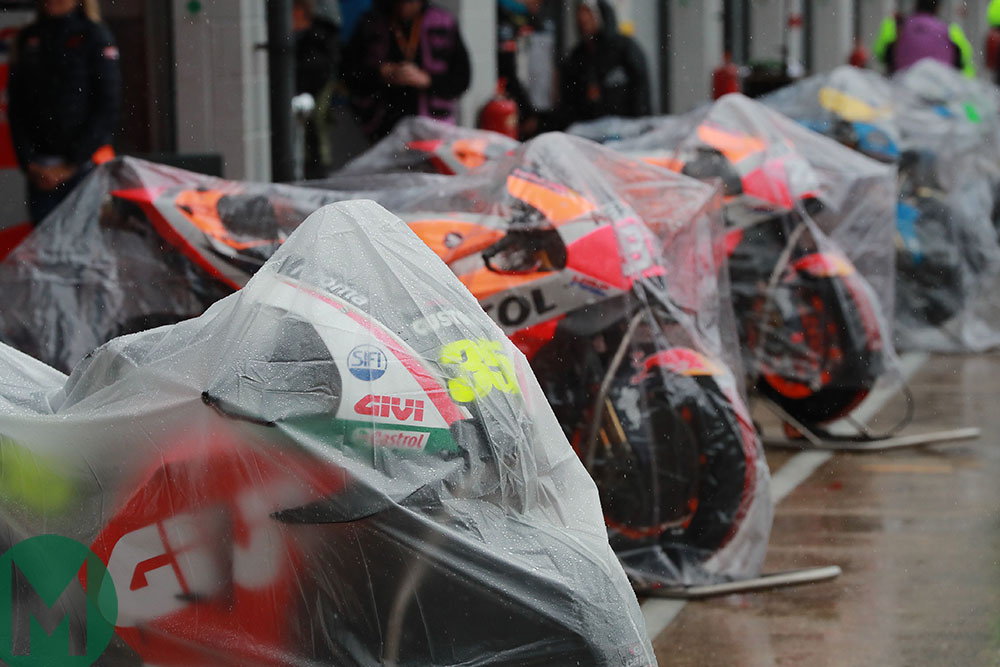 Motorbikes under rain covers at the 2018 MotoGP British Grand Prix at Silverstone