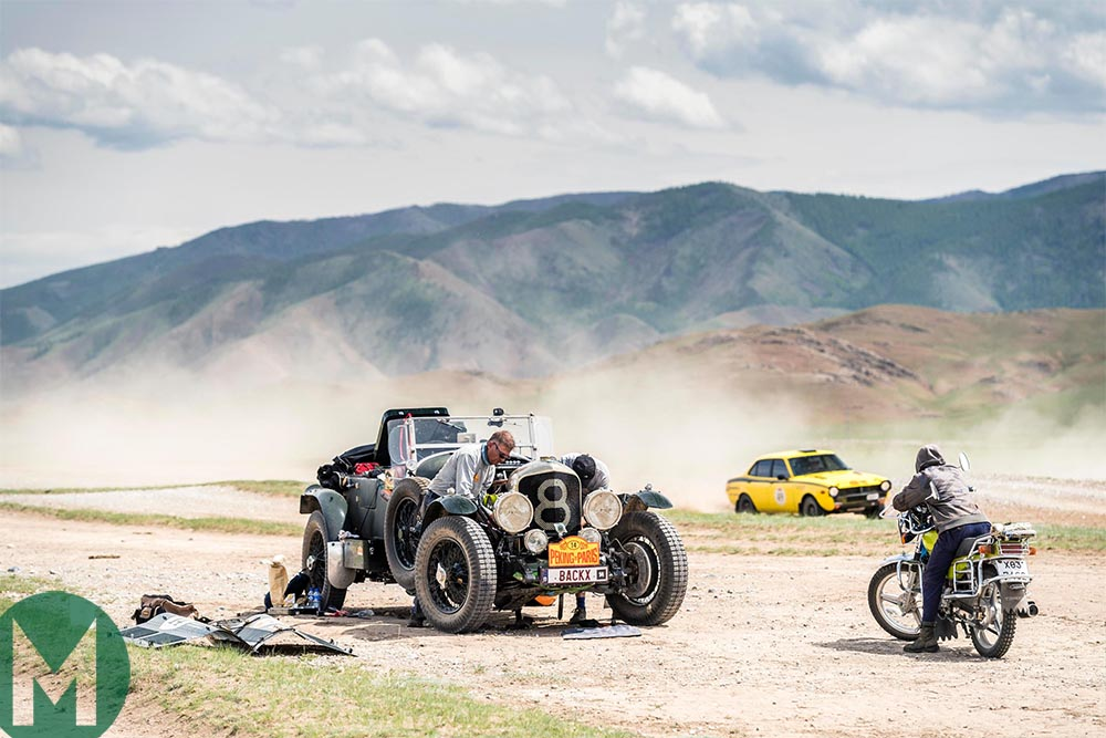 2019 Peking to Paris rally - Artur Lukasiewicz and Bill Cleyndert perform some maintenance on their 1931 Chrysler CM 6