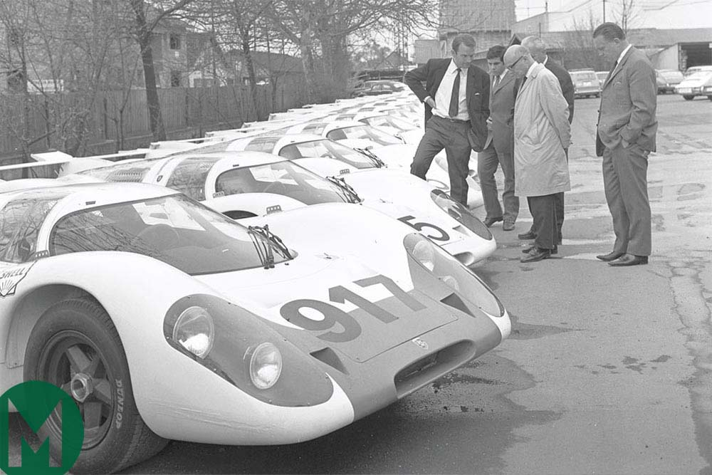 Ferdinand Piëch stands next to 25 Porsche 917s built in accordance with FIA homologation rules