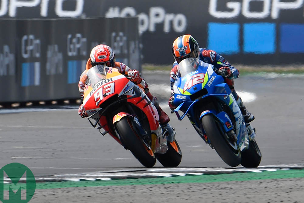 Rins attempts to overtake Marquez on the outside of Woodcote at the 2019 MotoGP British Grand Prix