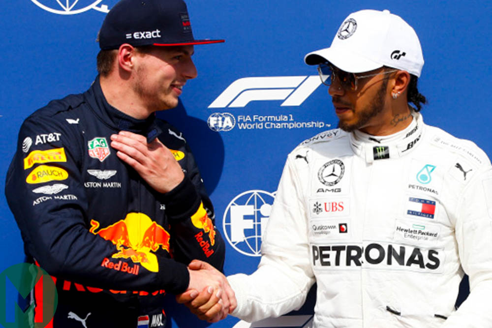 Max Verstappen and Lewis Hamilton shake hands after qualifying for the 2019 German Grand Prix