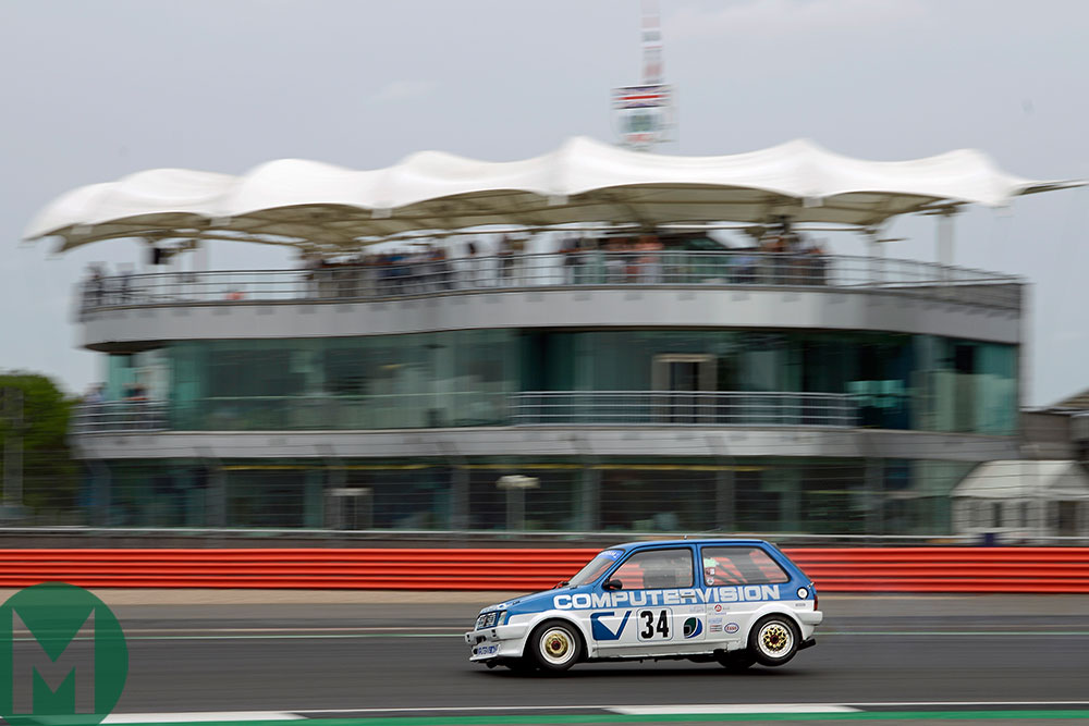 Patrick Watts gets on three wheels in his MG Metro Turbo at Silverstone Classic