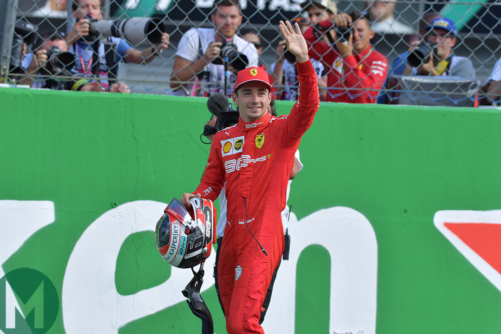 Charles Leclerc waves to the crowd after gaining pole position for the 2019 Formula 1 Italian Grand Prix