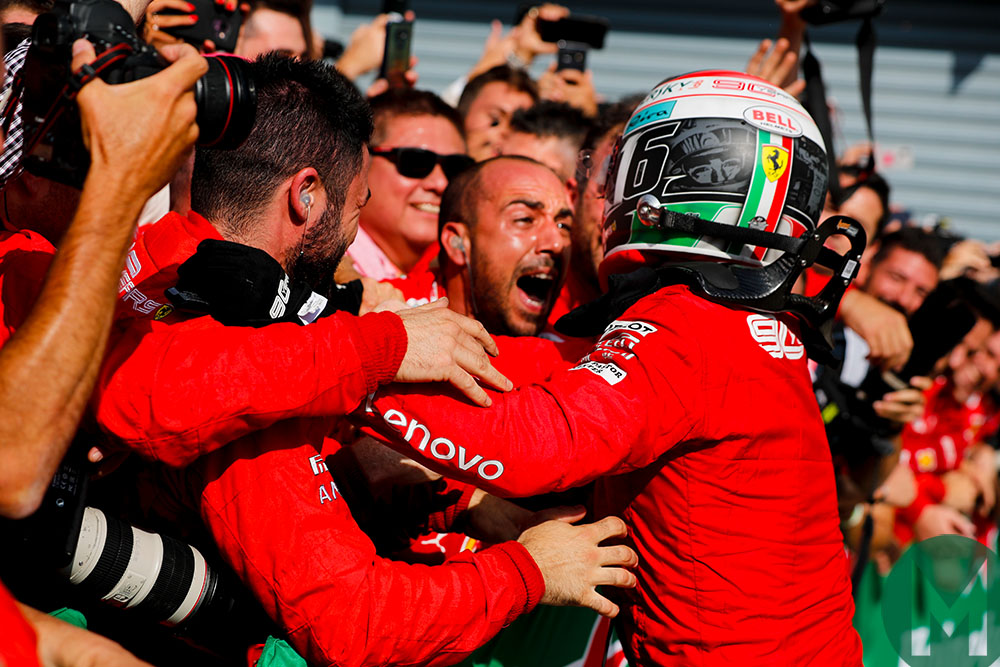Charles Leclerc embraces his mechanics after winning the 2019 Italian Grand Prix