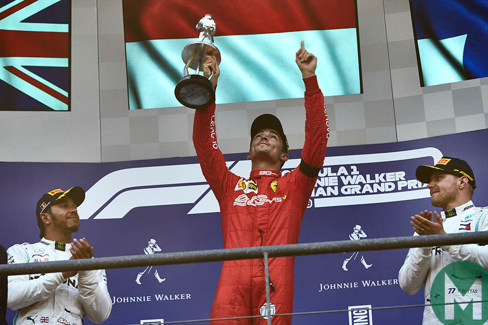 Charles Leclerc raises his trophy and finger to the sky in memory of Anthoine Hubert at the 2019 F1 Belgian Grand Prix