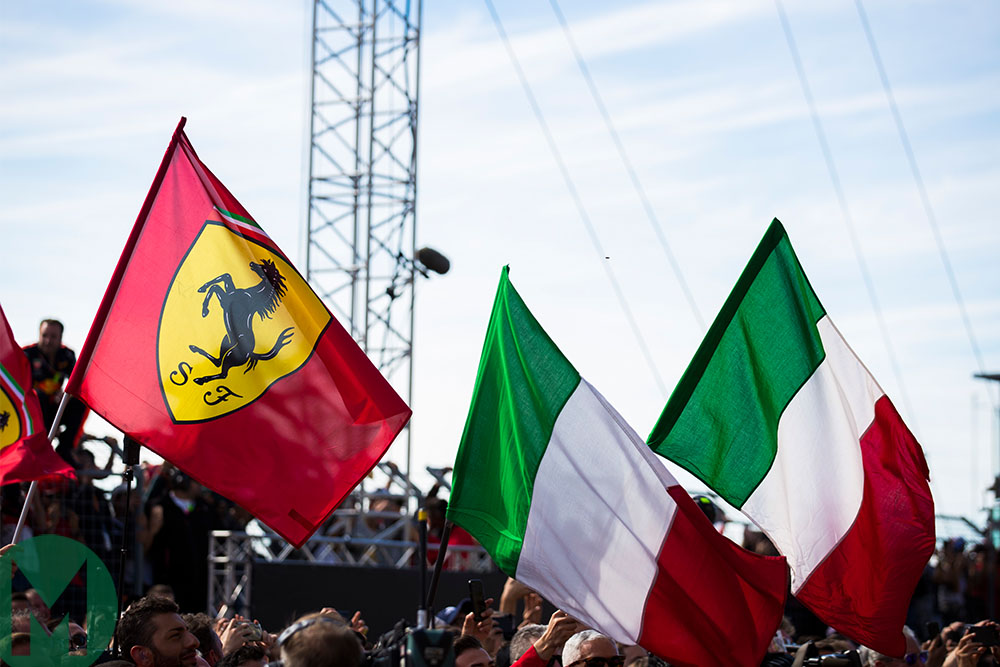 Ferrari and Italian flags underneath the Monza podium after the 2018 Italian Grand Prix