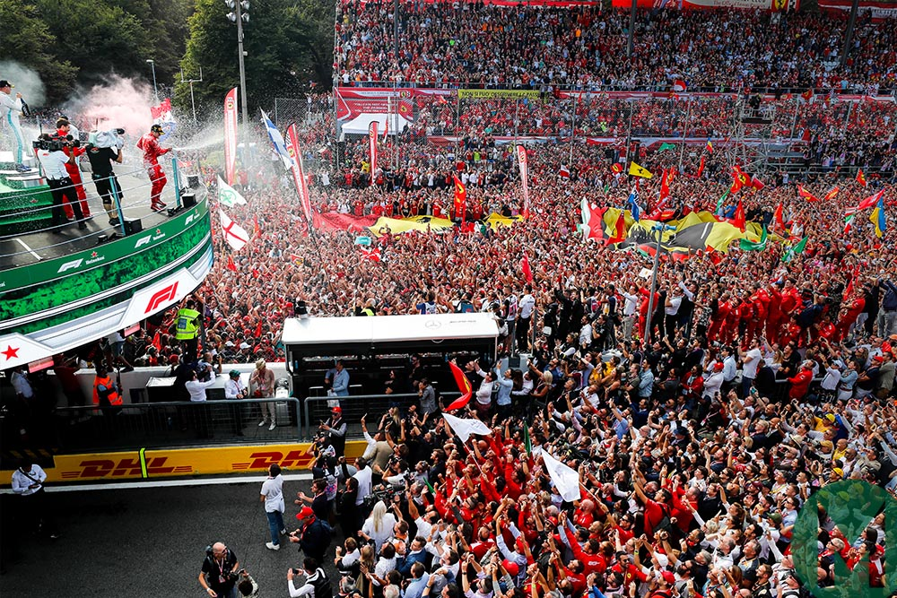 Podium champagne celebrations in front of thousands of Tifosi after Charles Leclerc wins he 2019 Italian Grand Prix at Monza