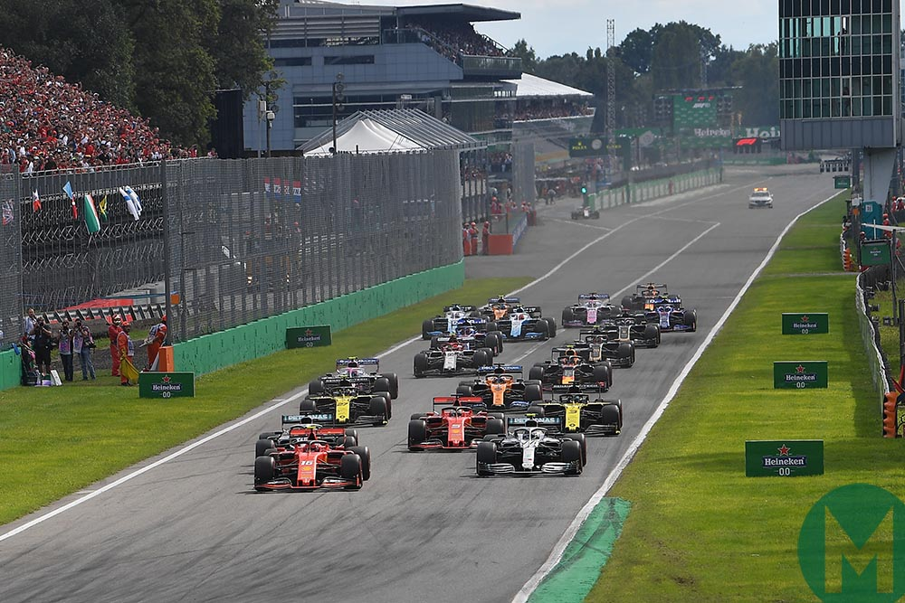F1 cars get away from the grid in front of packed grandstands at the start of the 2019 Italian Grand Prix
