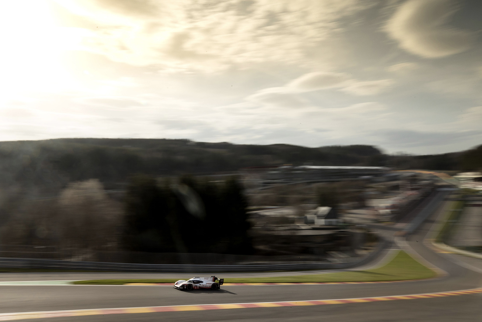 Porsche 919 Hybrid Evo drives up the hill from Eau Rouge at Spa
