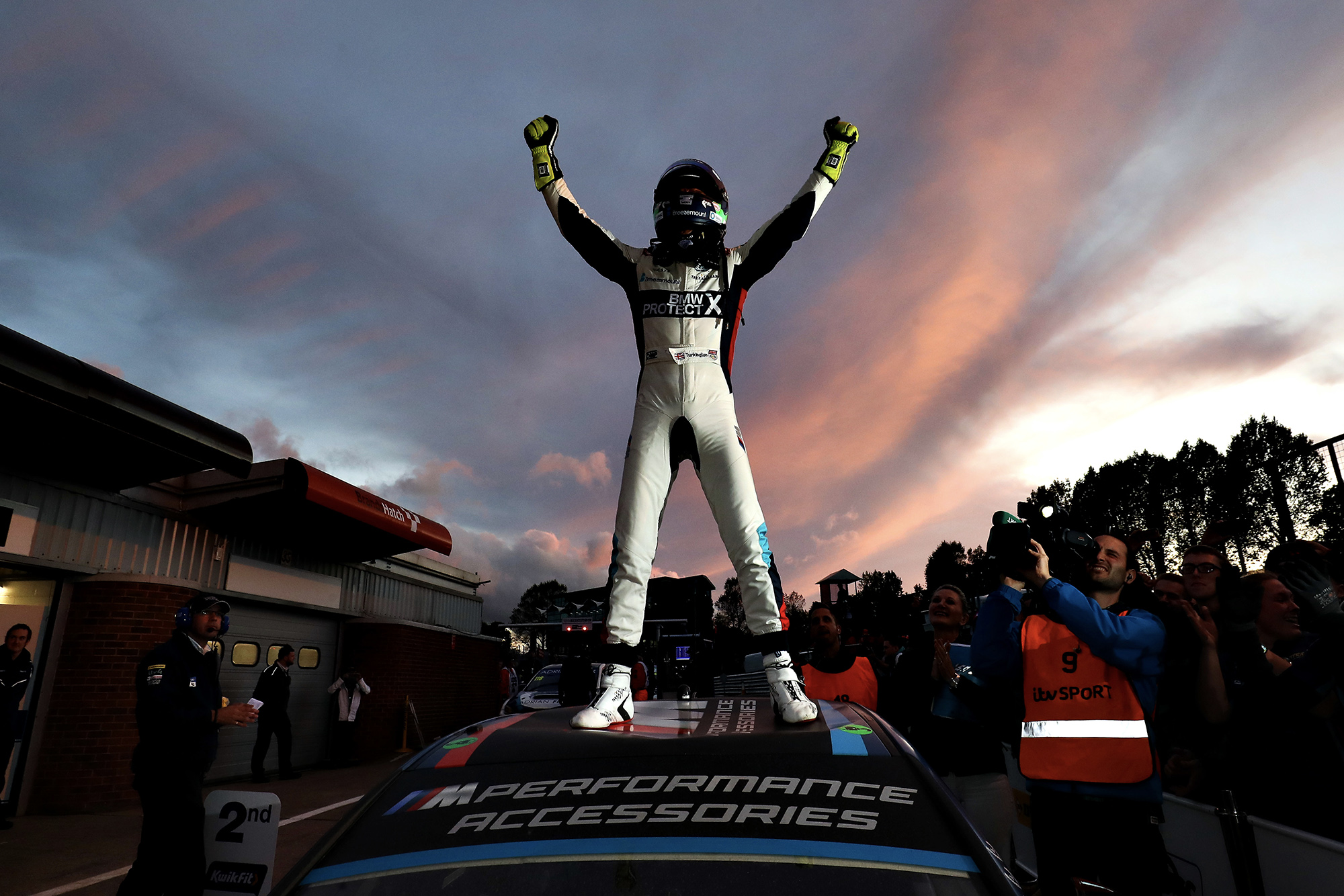 Colin Turkington stands on his car as he celebrates winning the 2019 BTCC championship at Brands Hatch