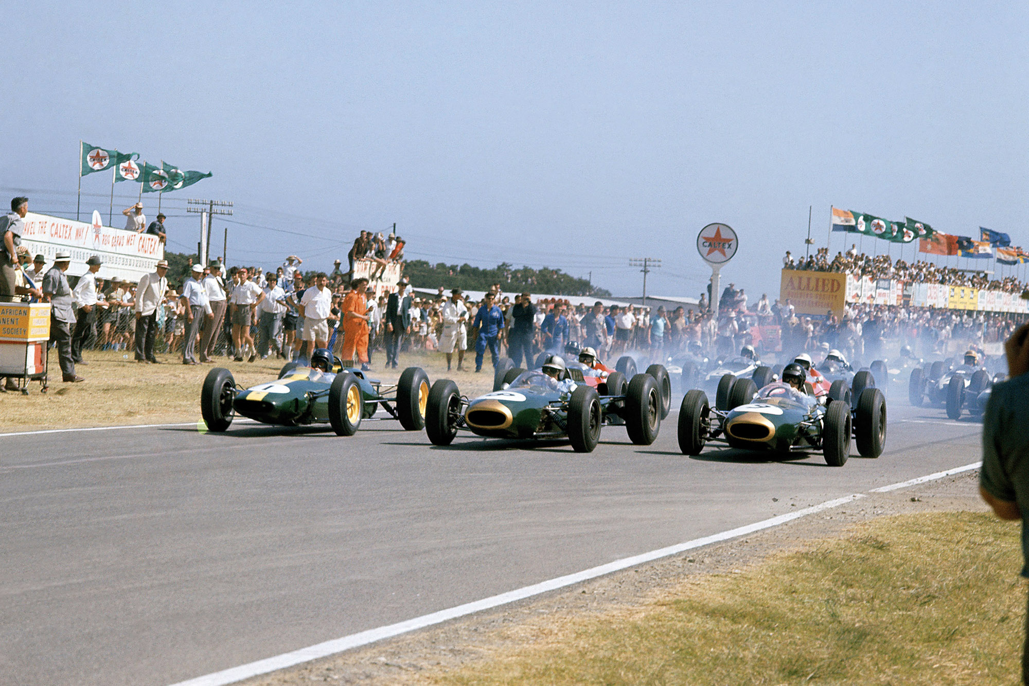 Jim Clark, Jack Brabham and Dan Gurney lead at the start of the 1963 South African Grand Prix